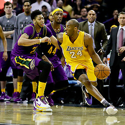 Feb 4, 2016; New Orleans, LA, USA; Los Angeles Lakers forward Kobe Bryant (24) is defended by New Orleans Pelicans forward Anthony Davis (23) during  the fourth quarter of a game at the Smoothie King Center. The Lakers defeated the Pelicans 99-96. Mandatory Credit: Derick E. Hingle-USA TODAY Sports