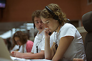 A young lady European Space Agency technician at Ariane launch control monitors rocket systems hours before a satellite launch