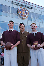 """Fringe performers pose outside Tynecastle Stadium.<br /> <br /> """"A War of Two Halves"""" tells the story of the 1914-15 Heart of Midlothian Team who signed up en masses to McCrae's Battalion <br /> <br /> Pictured: (l to r) Paul Beeson, Bryan Low and Charlie Wake.<br /> <br /> Alex Todd   Edinburgh Elite media"""