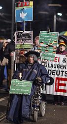 11.01.2016, Innenstadt Leipzig, Leipzig, GER, Kundgebung der Legida zum ersten Jahrestag, im Bild Anhaenger der Legida im Rollstuhl mit Plakaten bei der Kundgebung der Legida zum ersten Jahrestag // demonstration of Leipzig' s Europeans against the Islamization of the West (LEGIDA), a group linked with the PEGIDA movement, in Innenstadt Leipzig in Leipzig, Germany on 2016/01/11. EXPA Pictures © 2016, PhotoCredit: EXPA/ Eibner-Pressefoto/ Hommes<br /> <br /> *****ATTENTION - OUT of GER*****