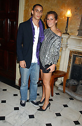 ALEX DELLAL and his sister CHARLOTTE DELLAL at a party following the TopShop Unique fashion show held at Home House, Portman Square, London on 19th September 2005.<br />
