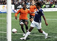 Fotball, 17. april 2011 ,  Tippeligaen , Eliteserien<br /> Strømsgodset - Sarpsborg 5-2<br /> <br /> Ola Kamara , SIF , scorer her ett av sine to mål for dagen. Bak:  Hugues Wembangomo , Sarpsborg