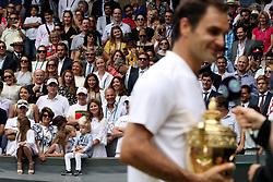 Charlene Riva Federer, Myla Rose Federer, Lenny Federer, Leo Federer, with their mother Mirka Federer and grandmother, Lynette Federer after Roger Federer wins the the Gentlemen's Singles Final on day thirteen of the Wimbledon Championships at The All England Lawn Tennis and Croquet Club, Wimbledon.
