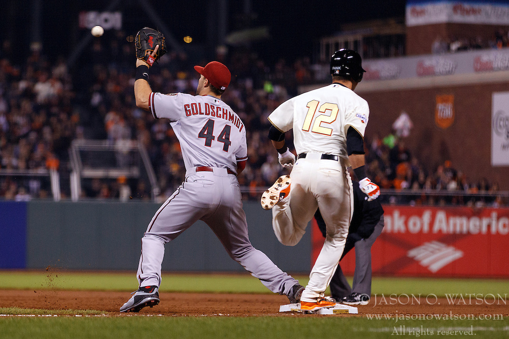 SAN FRANCISCO, CA - APRIL 18:  Joe Panik #12 of the San Francisco Giants beats a throw to Paul Goldschmidt #44 of the Arizona Diamondbacks for a single during the eighth inning at AT&T Park on April 18, 2015 in San Francisco, California.  The San Francisco Giants defeated the Arizona Diamondbacks 4-1. (Photo by Jason O. Watson/Getty Images) *** Local Caption *** Joe Panik; Paul Goldschmidt