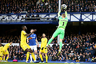 Everton goalkeeper Jordan Pickford (1) gets up to gather the high ball during the Premier League match between Everton and Chelsea at Goodison Park, Liverpool, England on 17 March 2019.