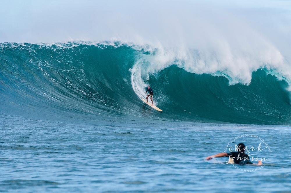 Surfing big waves in Hawaii