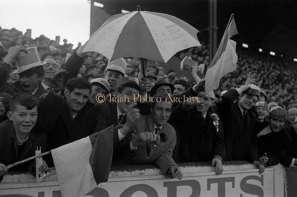 """06/02/1966<br /> 02/06/1966<br /> 06 February 1966<br /> Shamrock Rovers v Waterford at Milltown, Dublin. Some """"Blues"""" supporters who came well equipped for the match."""