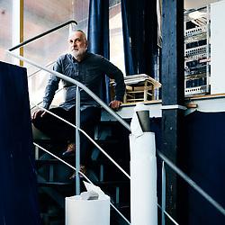 Jean-Marc Rochette, painter, illustrator and comics creator, posing in his studio. Paris, France. June 15, 2019.<br /> Jean-Marc Rochette, peintre, illustrateur et dessinateur de bande-dessinee, prenant la pose dans son atelier d'artiste. Paris, France. 15 juin 2019.