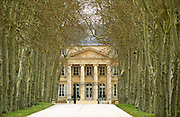 The entrance gate and building of Chateau Margaux, tree lined road allee, frontispiece and columns pillars, Chateau Margaux, Medoc, Bordeaux Gironde Aquitaine France Europe