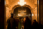 "Pilgrims enter the gates of the Golden Temple at night. Sikhism's holiest of ""Gudwaras"", places of worship, Amritsar, Punjab, India."