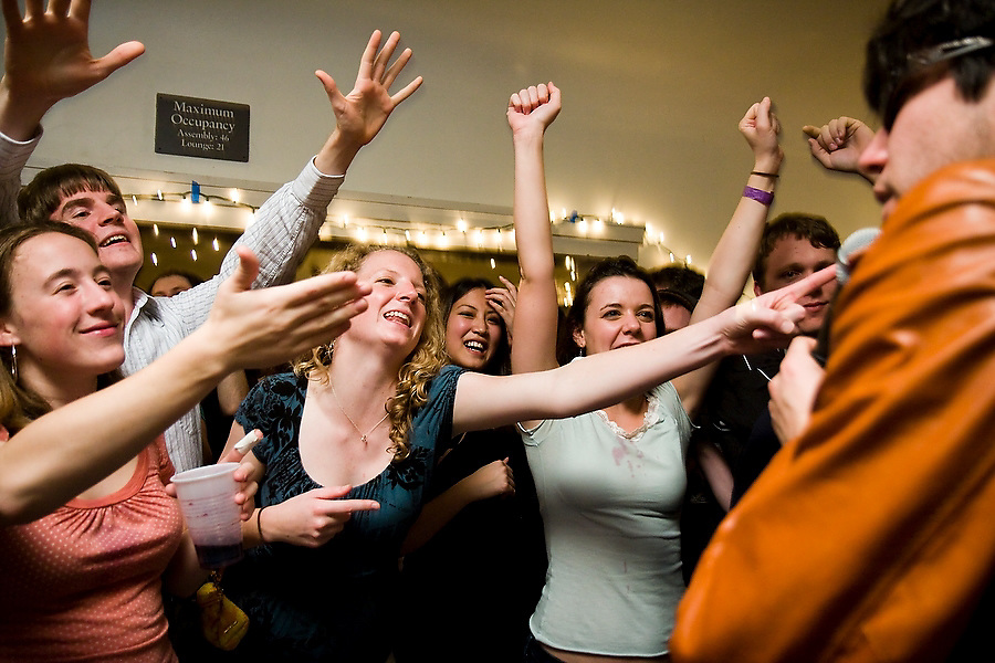 Fans cheer during a performance by Jimmy Delgadillo, right, and the rest of the 12-piece Stanford student band TGIFunk at the Maison Francaise student house in Stanford, California on February 15, 2008.