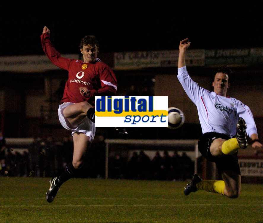 Photo: Jed Wee.<br /> Manchester United Reserves v Liverpool Reserves.<br /> 05/12/2005.<br /> <br /> Manchester United's Ole Gunnar Solskjaer (L) fires a shot in as Liverpool's Miguel Roque-Farrero tries to get a block in.