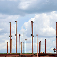 070815  Adron Gardner/Independent<br /> <br /> Workers walk along beams during construction of a new elementary school in Zuni Wednesday.