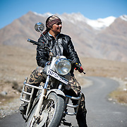 Scene from a group of motorcycle riders riding Royal Enfield bikes on a tour from Manali to Spiti in HImachal Pradesh Moksha is India's first woman to become a professional in motor-biking.