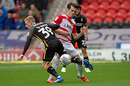 Doncaster Rovers forward John Marquis battles with Bradford city midfielder Lewis O'Brien during the EFL Sky Bet League 1 match between Doncaster Rovers and Bradford City at the Keepmoat Stadium, Doncaster, England on 22 September 2018.