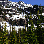 Sperry Chalet buried among the fir trees and rock ledges in Glacier National Park.