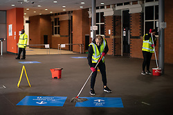 © Licensed to London News Pictures . 14/04/2020. Manchester, UK. Cleaners work to keep floors clean . The National Health Service has built a 648 bed field hospital for the treatment of Covid-19 patients , at the historical railway station terminus which now forms the main hall of the Manchester Central Convention Centre . The facility is due to open this week (commencing Easter Monday , 13th April 2020 ) and will treat patients from across the North West of England , providing them with general medical care and oxygen therapy after discharge from Intensive Care Units . Photo credit : Joel Goodman/LNP