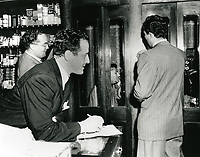 1945 Jack Mulcahy, Alan Gordon and Lowell Erlech wait while Sidney Skolsky is on the phone at Schwab's Pharmacy