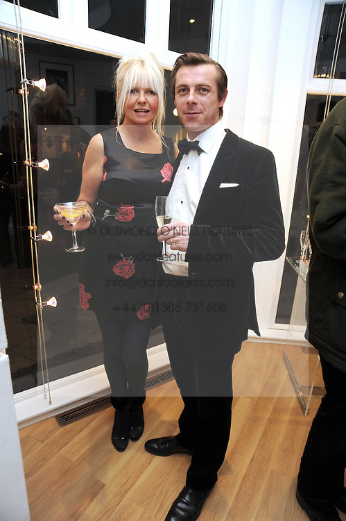 LINDSEY CARLOS CLARKE and the HON.DANIEL BRENNAN at a private view of 'Most Wanted' an exhibition of photographs held at The Little Black Gallery, Park Walk, London on 27th November 2008.