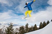 Jesse Young flies down a ridge south of Snow King on Friday, taking advantage of the sunny weather to revisit a favorite spot and get some air time above the wet snow.