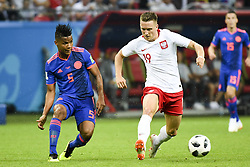 June 25, 2018 - Kazan, Russia - Piotr Zielinski of Poland fights for the ball Wilmar Barrios of Colombia during the 2018 FIFA World Cup Group H match between Poland and Colombia at Kazan Arena in Kazan, Russia on June 24, 2018  (Credit Image: © Andrew Surma/NurPhoto via ZUMA Press)
