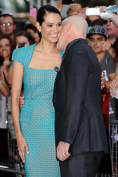 Red 2 UK film premiere.<br /> Bruce Willis and wife Emma Heming during the premiere of the sequel to 2010's graphic novel adaption, about a group of retired assassins. <br /> Empire Leicester Square<br /> London, United Kingdom<br /> Monday, 22nd July 2013<br /> Picture by i-Images