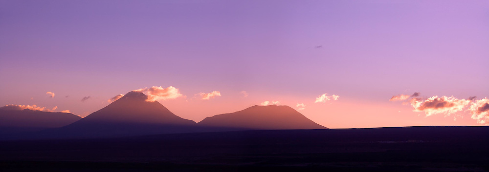 Sunrise behind the Andes Mountain Range, with the Altiplano (High Andean Plateau) and Licancabur volcano in silhouette, Atacama desert, Chile, South America