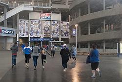 April 13, 2018 - Kansas City, MO, U.S. - KANSAS Kansas City, MO - APRIL 13: Fans run toward the stadium as it begins to rain before the MLB regular season game between the Kansas City Royals and the Los Angeles Angels on Friday April 13th, 2018 at Kauffman Stadium in Kansas City, MO.  (Photo by Nick Tre. Smith/Icon Sportswire) (Credit Image: © Nick Tre. Smith/Icon SMI via ZUMA Press)