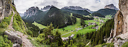 Wolkenstein Castle was built in the 1200s, was named for a 1400s troubadour, collapsed in 1525 AD, was rebuilt but then fell into disrepair. Vallunga/Langental valley makes a perfect walking destination in Puez-Geisler Nature Park, in Val Gardena, Dolomites, South Tyrol, Italy, Europe. The beautiful ski resort of Selva di Val Gardena (German: Wolkenstein in Gröden; Ladin: Sëlva Gherdëine) makes a great hiking base in the Dolomites, in the South Tyrol region (Trentino-Alto Adige/Südtirol). For our favorite hike in the Dolomiti, start from Selva with the first morning bus to Ortisei, take the Seceda lift, admire great views up at the cross on the edge of Val di Funes (Villnöss), then walk 12 miles (2000 feet up, 5000 feet down) via the steep pass Furcela Forces De Sieles (Forcella Forces de Sielles) to beautiful Vallunga (trail #2 to 16), finishing where you started in Selva. The hike traverses the Geisler/Odle and Puez Groups from verdant pastures to alpine wonders, all preserved in a vast Nature Park: Parco Naturale Puez-Odle (German: Naturpark Puez-Geisler; Ladin: Parch Natural Pöz-Odles). UNESCO honored the Dolomites as a natural World Heritage Site in 2009. This panorama was stitched from 8 overlapping photos.