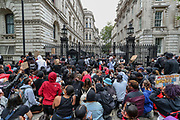 Protesters gather during a demonstration in Whitehall road nearby Downing Street in London on Wednesday, June 3, 2020, over the death of George Floyd, a black man who died after being restrained by Minneapolis police officers on May 25. Protests have taken place across America and internationally after a white Minneapolis police officer pressed his knee against Floyd's neck while the handcuffed black man called out that he couldn't breathe. The officer, Derek Chauvin, has been fired and charged with murder. (Photo/ Vudi Xhymshiti)