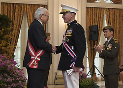 Jun 2, 2017 - Singapore, Singapore - Marine Corps Gen. Joe Dunford, chairman of the Joint Chiefs of Staff, speaks with Singaporean President Tony Tan after receiving Singapore's Military Distinguished Service Order medal in Newton, Singapore, June 2, 2017. Dunford is in Singapore to attend the Shangri-La Dialogue, an Asia-focused defense summit, where he will meet with regional allies and counterparts to discuss common security issues. DoD photo by Navy Petty Officer 2nd Class Dominique A. Pineiro Dunford Receives Singapore's Distinguished Service Award. Singapore's president presented Marine Corps Gen. Joe Dunford, the chairman of the Joint Chiefs of Staff, with Singapore's Military Distinguished Service Order medal for the general's steadfast support of the U.S.-Singapore partnership. (Credit Image: ? Dominique A. Pineiro/DoD via ZUMA Wire/ZUMAPRESS.com)