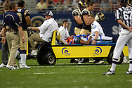 Seattle safety Michael Boulware (C) is carted off the field after an injury in the first half against St. Louis at the Edward Jones Dome in St. Louis, Missouri, October 9, 2005.  Seattle beat St. Louis 37-31.