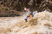 Kayaker in high water on the Rio Grande