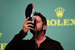 Formel 1: Grosser Preis der USA in Austin, Renntag / 231016<br /> <br /> ***Gerard Butler (GBR) Actor on the podium.<br /> 23.10.2016. Formula 1 World Championship, Rd 18, United States Grand Prix, Austin, Texas, USA, Race Day.<br /> ***