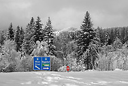 Unreliable Sightings - Motorway sign is a selective colour photo by photographer Paul Williams  of a blue motorway sign buried in snow in 2008 . .<br /> <br /> Visit our REPORTAGE & STREET PEOPLE PHOTO ART PRINT COLLECTIONS for more wall art photos to browse https://funkystock.photoshelter.com/gallery-collection/People-Photo-art-Prints-by-Photographer-Paul-Williams/C0000g1LA1LacMD8