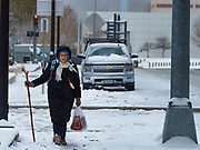 11 NOVEMBERS 2019 - DES MOINES, IOWA: A person walks on snow packed sidewalk in downtown Des Moines Monday morning. About three inches of snow fell in the Des Moines area Sunday night into Monday morning snarling the Monday morning rush hour and delaying central Iowa schools by about two hours.          PHOTO BY JACK KURTZ