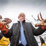 STROMNESS, SCOTLAND - JULY 23: PM Boris Johnson at Stromness Harbour with crabs caught on the Carvela.This week marks one year as U.K. Prime Minister for Conservative Party leader Boris Johnson. Today he is visiting businesses in the Orkney Islands in Scotland to reaffirm his commitment to supporting all parts of the UK through the Coronavirus pandemic. Later he will visit a military base in Moray to thank Military personnel for their service. on July 23, 2020 in Stromness, Scotland. (Photo by Robert Perry/Getty Images)