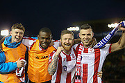 Lincoln City Forward Theo Robinson, Lincoln City Midfielder Alan Power and Lincoln City Forward Jack Muldoon celebrate victory with scarf during the The FA Cup fourth round match between Lincoln City and Brighton and Hove Albion at Sincil Bank, Lincoln, United Kingdom on 28 January 2017. Photo by Phil Duncan.