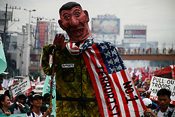 July 24, 2017 - Philippines - Thousands of protesters marched through Commonwealth avenue in Quezon City towards the House of Representatives, Monday noon time. The protesters aired their dismay during President Duterte's second State of the Nation Address. The protesters also called for the end of Martial Law in Mindanao, and the end of drug related killings in the country. (Credit Image: © J Gerard Seguia via ZUMA Wire)