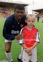 Kanu with the Arsenal mascot. Bradford City 1:1 Arsenal, F.A. Carling Premiership, 9/9/2000. Credit Colorsport / Stuart MacFarlane.