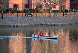 © Licensed to London News Pictures; 24/03/2020; Bristol, UK. Coronavirus Pandemic; A canoeist enjoys exercise in the late evening sunshine in Bristol Docks on the first day of the coronavirus lockdown after the Prime Minister spoke to the nation on TV yesterday evening and announced a lockdown to prevent the spread of coronavirus, with the biggest restrictions on freedom of movement ever imposed in the UK. People are told to stay at home except for essential work that cannot be done at home, shopping for food, medical appointments and taking exercise once a day all while maintaining social distance. Photo credit: Simon Chapman/LNP.
