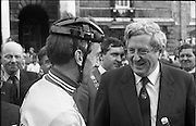 Nissan International Cycle Race..1986..01.10.1986..10.01.1986..1st October 1986..The Nissan Classic began today from Trinity College,Dublin. The offical race starter was The Taoiseach,Dr Garrett FitzGerald TD. He was accompanied by the Minister for Sport,Mr Sean Barrett TD..Sean Kelly was returning to defend his title but his opposition included Greg LeMond, the 1983 world champion and the winner of the Tour de France of the previous July. Roche was out due to his injured leg. Adri van der Poel was back with 1980 Tour de France winner and 1985 world champion Joop Zoetemelk. Teun van Vliet was back too. The winner of the green jersey of the Tour de France that July, Eric Vanderaerden was there as well as Australians Phil Anderson and Alan Peiper as well the Scottish cyclist Robert Millar...The Taoiseach,Dr Garrett FitzGerald, is pictured chatting with Sean Kelly at the race start point in Trinity College,Dublin.