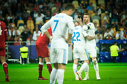 Isco of Real Madrid and Sergio Ramos of Real Madrid celebrate during the UEFA Champions League final football match between Liverpool and Real Madrid at the Olympic Stadium in Kiev, Ukraine on May 26, 2018.Photo by Sandi Fiser / Sportida