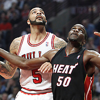 14 March 2012: Miami Heat center Joel Anthony (50) vies for the rebound with Chicago Bulls power forward Carlos Boozer (5) during the Chicago Bulls 106-102 victory over the Miami Heat at the United Center, Chicago, Illinois, USA.