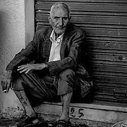 Old man sitting bw, Nabeul, Tunisia (November 2005)
