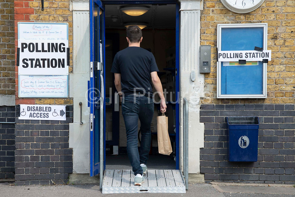 A man enter a polling station to cast his vote on 23rd May 2019 in Greenwich ,South- East London, England, United Kingdom. Polls are open for the European Parliament elections. Voters will choose 73 MEPs in 12 multi-member regional constituencies in the UK with results announced once all EU nations have voted. The voting process expected to be completed by 10pm on Sunday.