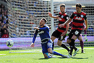 Cardiff City's Anthony Pilkington (13) goes down under a challenge from QPR's Clint Hill (6) and Alejandro Furling (18). Skybet football league championship match, Cardiff city v Queens Park Rangers at the Cardiff city stadium in Cardiff, South Wales on Saturday 16th April 2016.<br /> pic by Carl Robertson, Andrew Orchard sports photography.