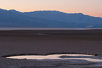 Evening reflections at Badwater, Death Valley National Park, California. At 282 feet below sea level, Badwater is the lowest point in North America.