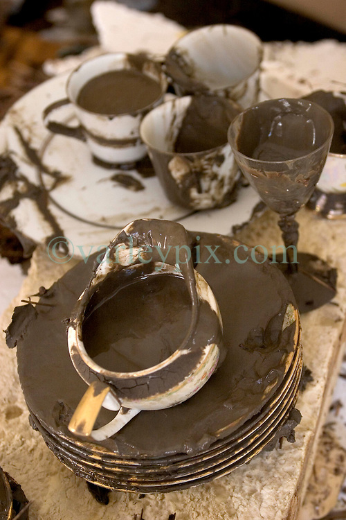 08 Sept 2005.  New Orleans, Louisiana. Hurricane Katrina aftermath. <br /> Venetian Isles in East New Orleans, where the tidal surge washed over the land and devastated homes and property. Grandmother's precious china saved from the mud at John and Peggy Lala's mud filled flood ravaged home.<br /> Photo; ©Charlie Varley/varleypix.com
