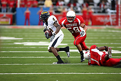 08 September 2007: Jesse Ceasar misses his dive for the legs of Racer Derrick Townsel, but Bill Hronec zeros in on Townsel's upper body. The Murray State Racers were defeated by the Illinois State Redbirds 43-17 in a nightcap at Hancock Stadium on the campus of Illinois State University in Normal Illinois.